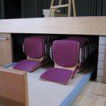 Stapelstuhl Staufach unter Bühne
